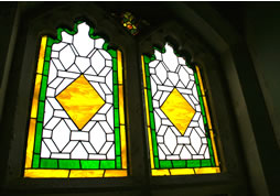 Traditional stone buildings can be enhanced by a  stained glass window by Deko Studio